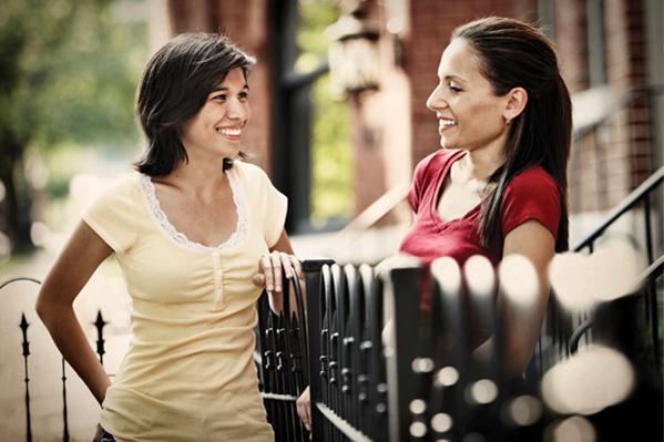 Women-Talking-at-Fence